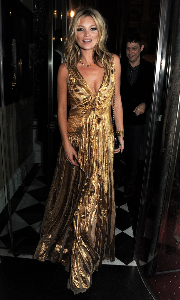 Kate Moss wore a gold Marc Jacobs dress to celebrate her book launch.