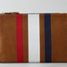 Clare Vivier's 3-stripe flat clutch ($184) is simple, classic, and reminds us of something we'd wear on a dreamy trip to Paris.