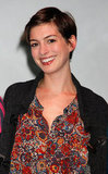 Anne Hathaway smiled big.