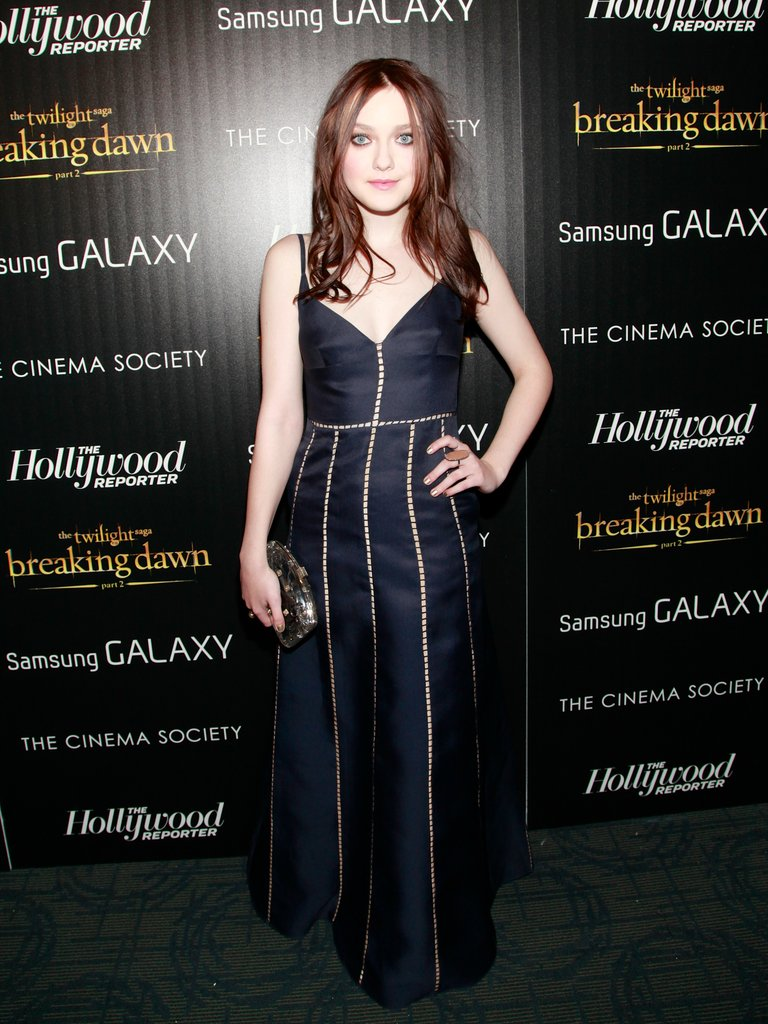 Dakota Fanning showed off her new brunette locks and a navy Valentino gown.