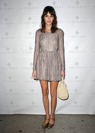 Alexa Chung's pale mauve lace dress by Lover is the kind of dress you could wear all Winter long. Just add tights and a classic black peacoat.