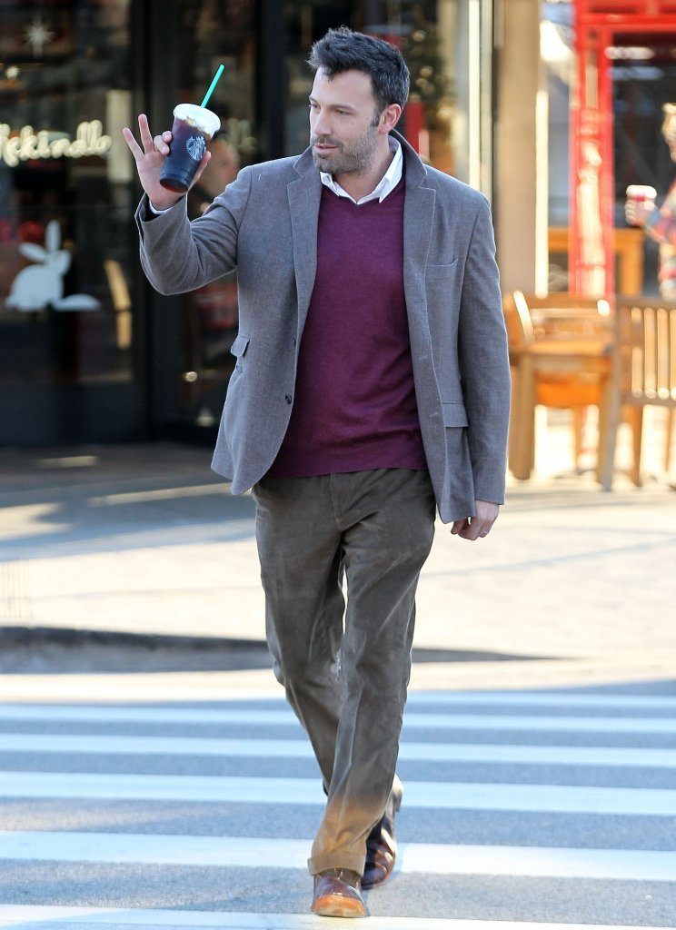 Ben Affleck waved to a fan as he crossed the street.