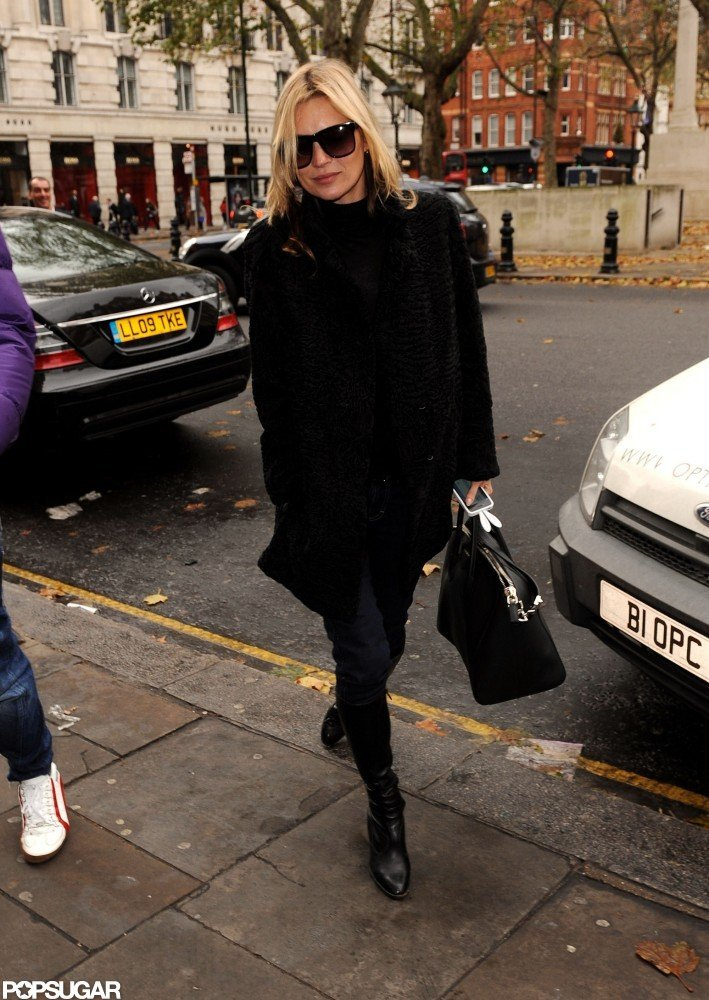 Kate Moss kept warm in a black jacket.
