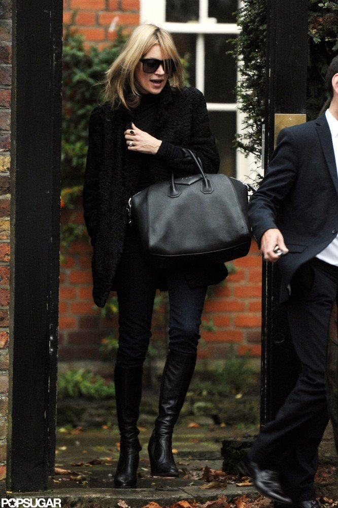 Kate Moss wore black boots.