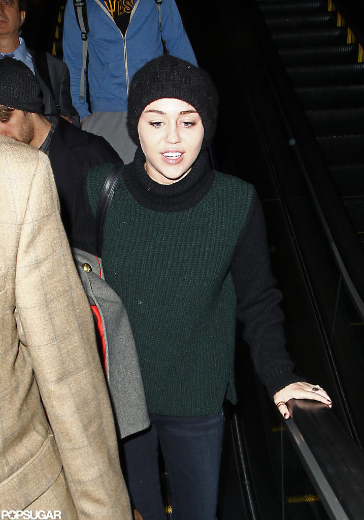 Miley Cyrus Returns to LA and Her Fiancé Liam Hemsworth