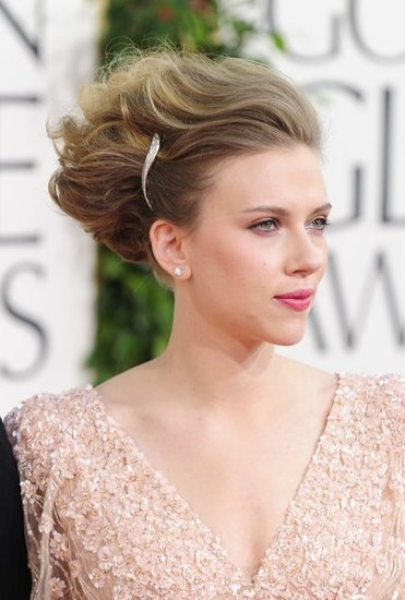 She executed a daring updo flawlessly at the 2011 Golden Globe Awards, accessorizing her style with a sparkly barrette.