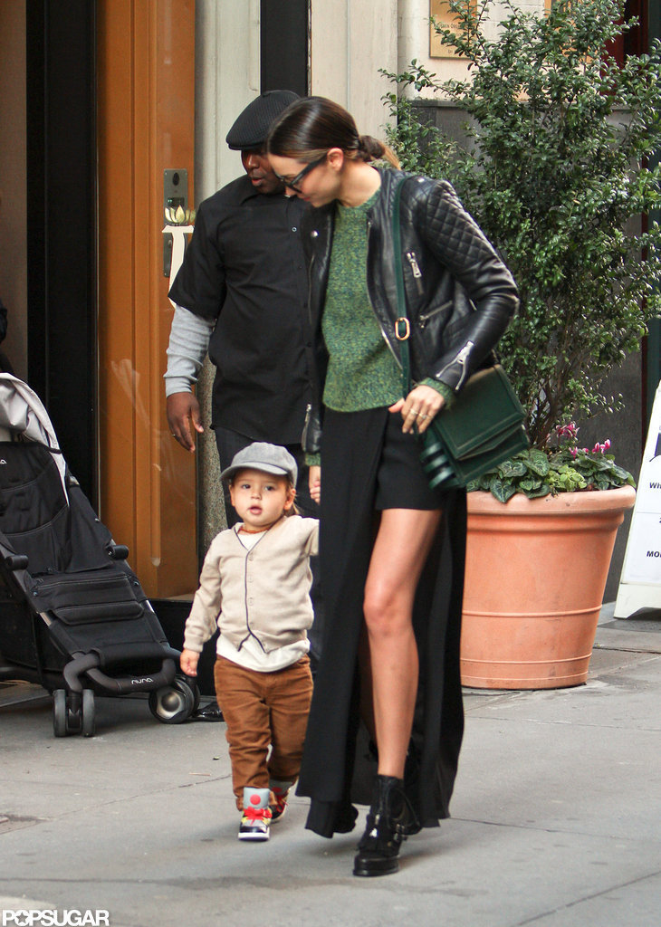 Miranda Kerr showed some leg under a short skirt with Flynn Bloom.