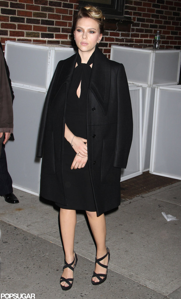 Scarlett Johansson wore a black jacket over her dress.