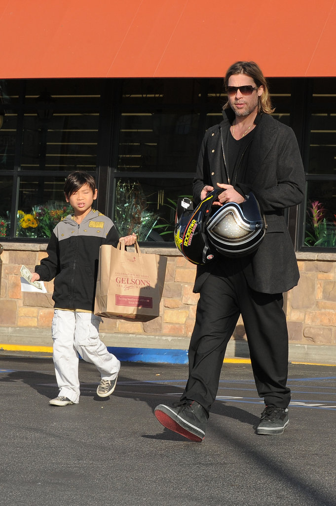 Brad Pitt and Pax rode Brad's motorcycle to Gelson's Market in LA on New Year's Eve day in January.