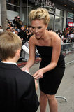 Scarlett Johansson made a little boy's day by signing an autograph at The Avengers premiere in Hollywood in April 2012.