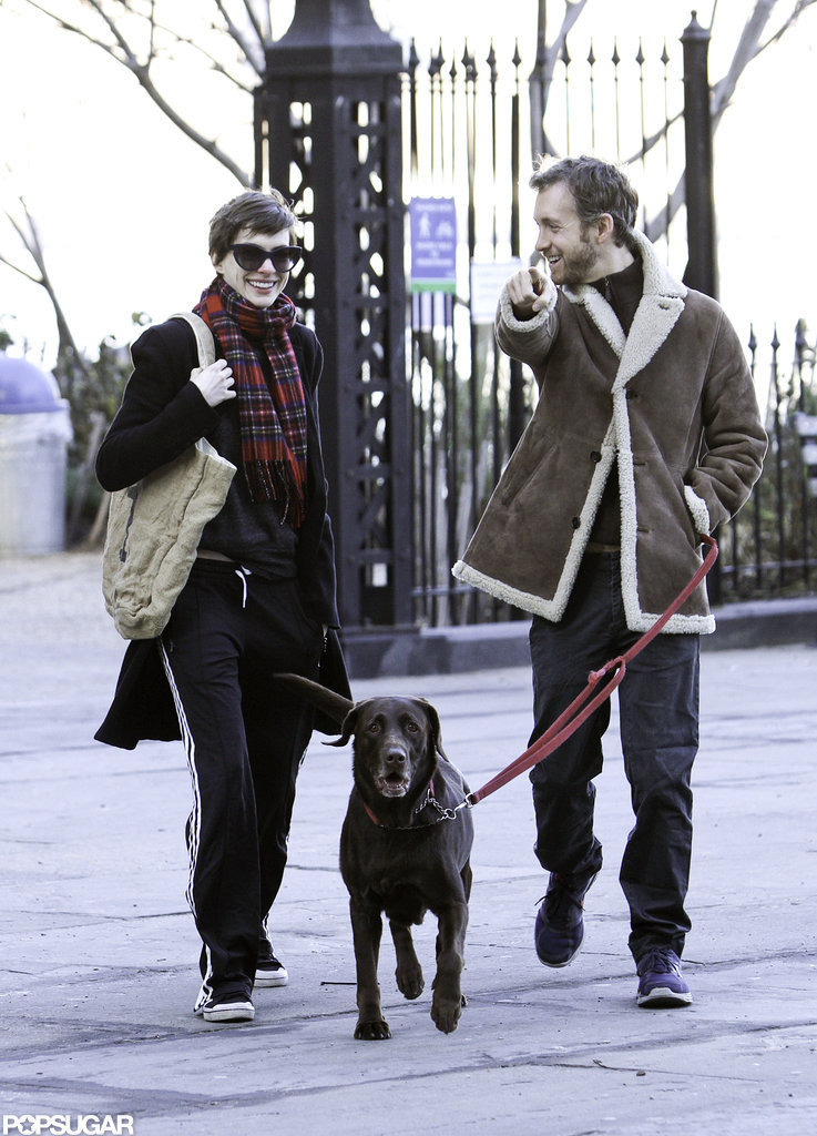 Adam Shulman and Anne Hathaway walked their dog in NYC.