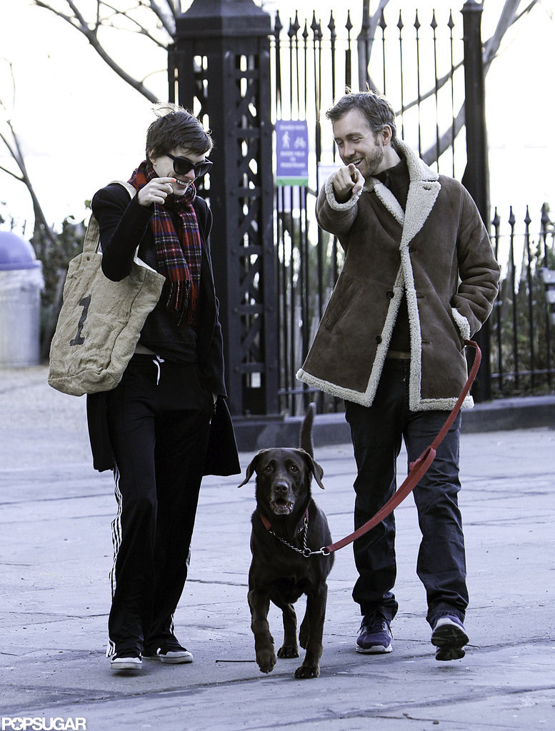 Anne Hathaway bundled up to take a walk with her dog and Adam Shulman in NYC.
