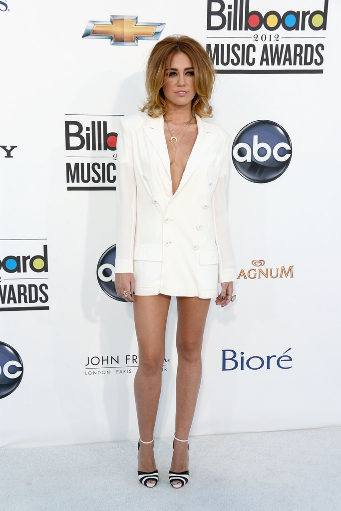 Miley had big hair and a short jacket at the 2012 Billboard Music Awards.