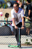 Gavin Rossdale hopped on a scooter at the park.