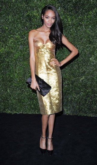 Jourdan Dunn showed off her svelte figure in a metallic gold strapless dress by Burberry paired with chic Burberry pumps and a satin clutch.
