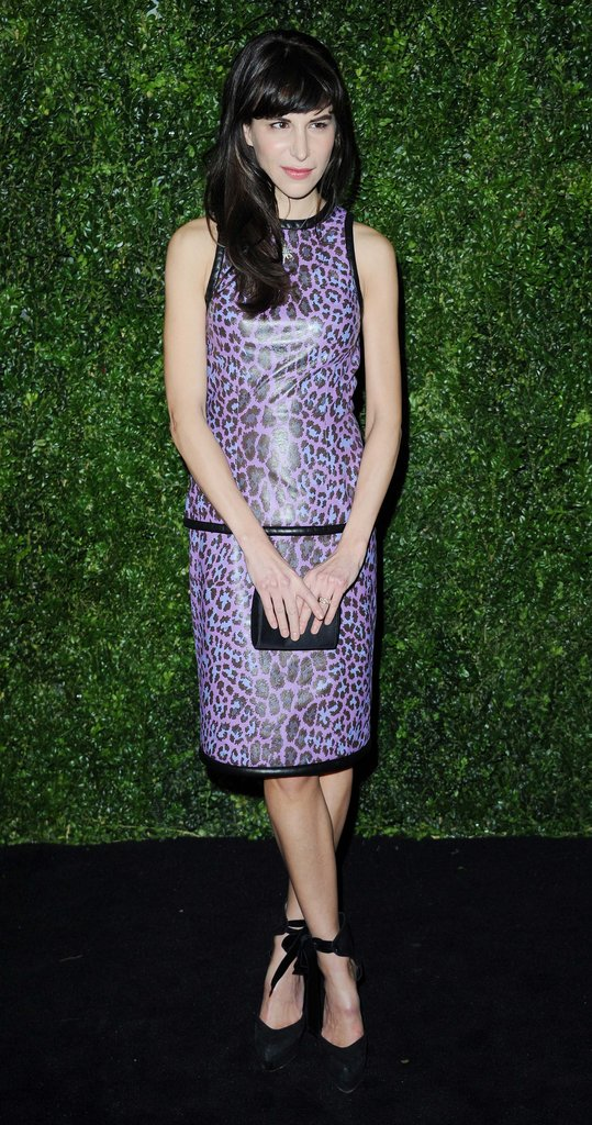 Caroline Sieber wore a purple leopard-print dress paired with ankle-wrap Louis Vuitton pumps.