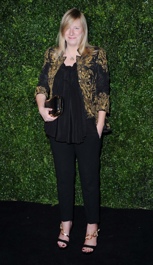 Alexander McQueen creative director Sarah Burton made an appearance on the black carpet wearing a baroque blazer paired with black separates and stunning accessories.