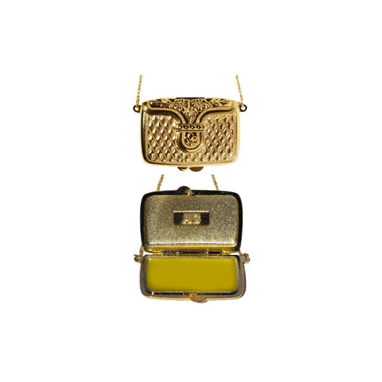 """If she's addicted to handbags, Andrea Garland's lip balm necklace ($46) is the perfect stocking stuffer. Inside the """"purse"""" is a lip balm made with all-natural ingredients such as shea butter and lavender. Package it in a pretty box, and it'll seem more expensive than it really is."""