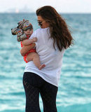 Kourtney Kardashian carried Penelope to the beach.