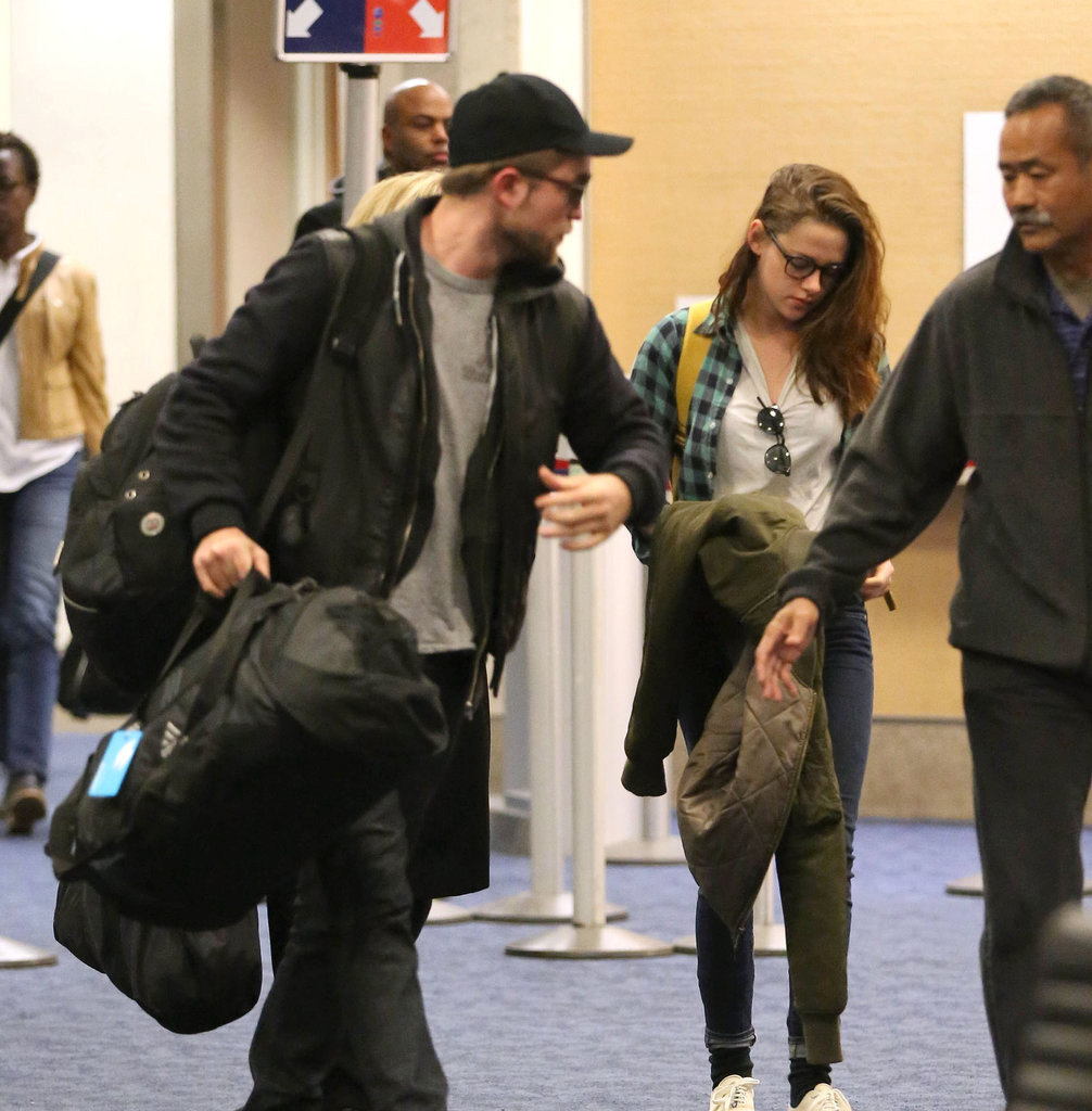 Robert Pattinson and Kristen Stewart landed back in LA.