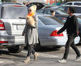 Gwen Stefani and Gavin Rossdale walked through a parking lot.
