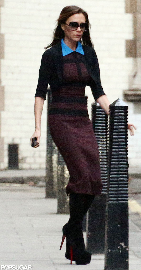 Victoria Beckham wore a maroon dress and black boots.