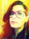 Debra Messing tried on a pair of red glasses. Source: Debra Messing on WhoSay