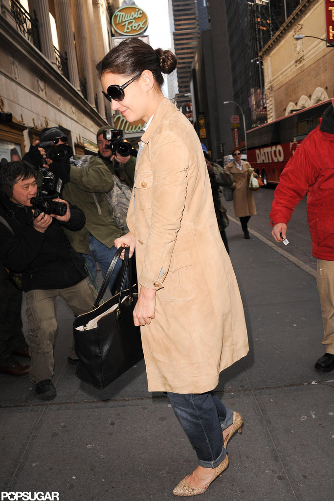 Katie Holmes kept warm in a camel-colored trench.