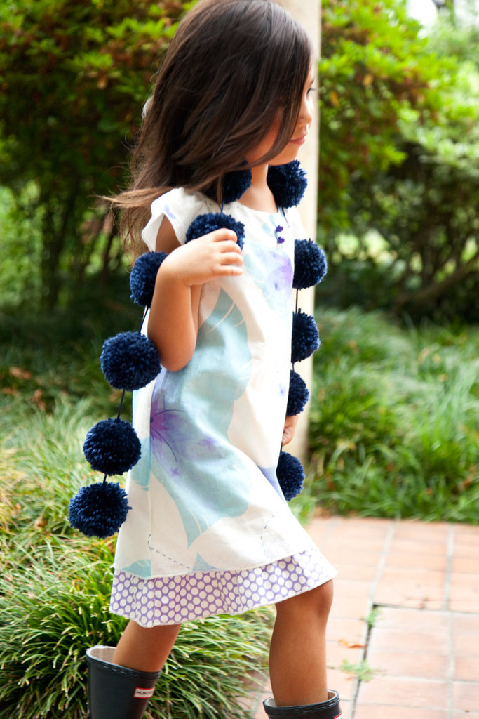 Rayil's Ambrosia dress ($78), made from Karishma cotton voile, and navy pom-pom stole ($28).