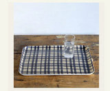 Navy, linen, and plaid? We totally see this patterned tray ($28) as a cool new way to serve up some PBRs.