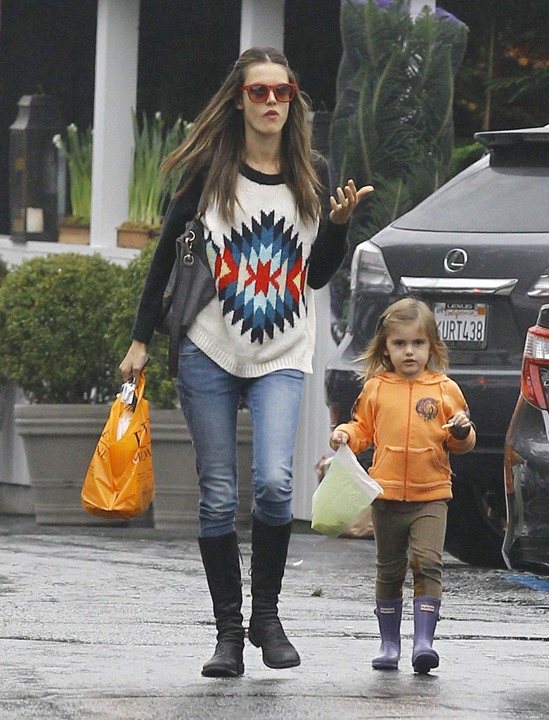 Alessandra Ambrosio and Anja braved the LA rain.