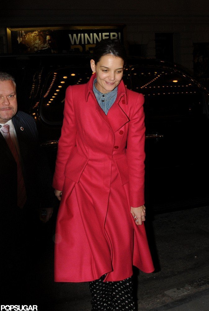 Kate Holmes wore a red coat in NYC.
