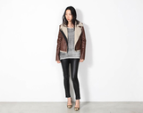 You might want to steal this one for yourself because it's just that cool . . . enter the shearling moto jacket from Mikkat Market ($59). It's the perfect complement to all your wintry layers.