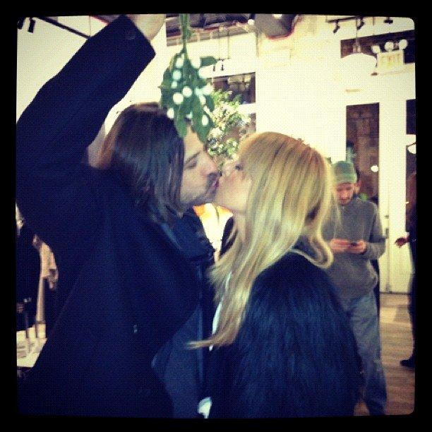 Rachel Zoe planted a kiss on husband Rodger Berman under the mistletoe. Source: Instagram user rachelzoe