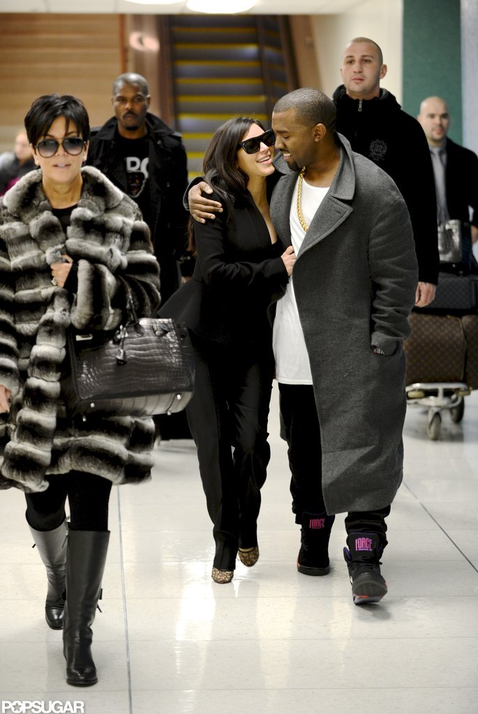 Kanye West and Kim Kardashian cuddled up at LAX.