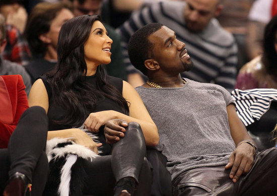 Kim Kardashian and Kanye West cuddled up courtside at a December 2012 Clippers game in LA.