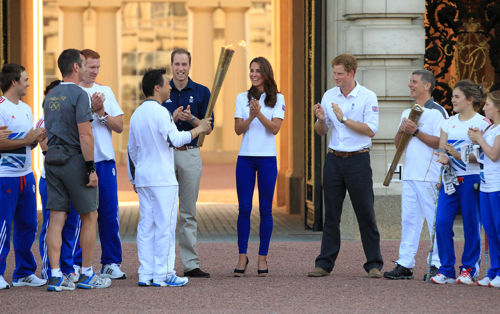 Prince Harry, Prince William, and Kate Middleton received the Olympic flame at Buckingham Palace in July.