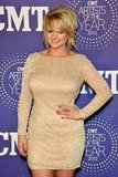 Miranda Lambert wore a nude sequined dress.