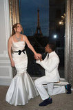 In April 2012, Mariah Carey and Nick Cannon renewed their vows on their fourth wedding anniversary in Paris. And, to fete the occasion, she wore a satin white fishtail gown, complete with gorgeous jewels and a black sash-tie bow.