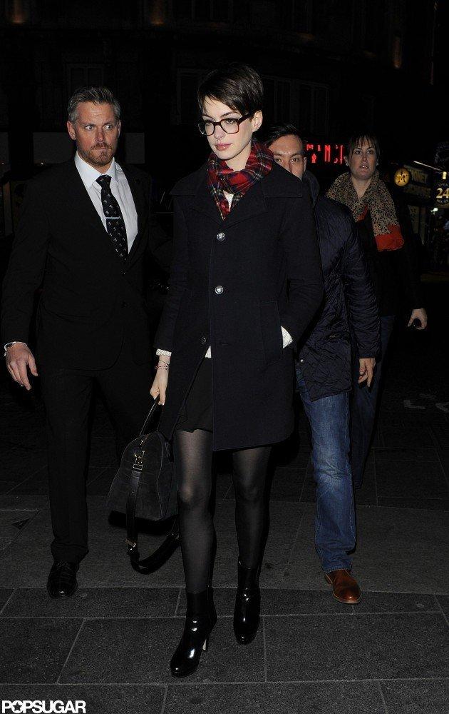 Anne Hathaway kept warm in a coat.