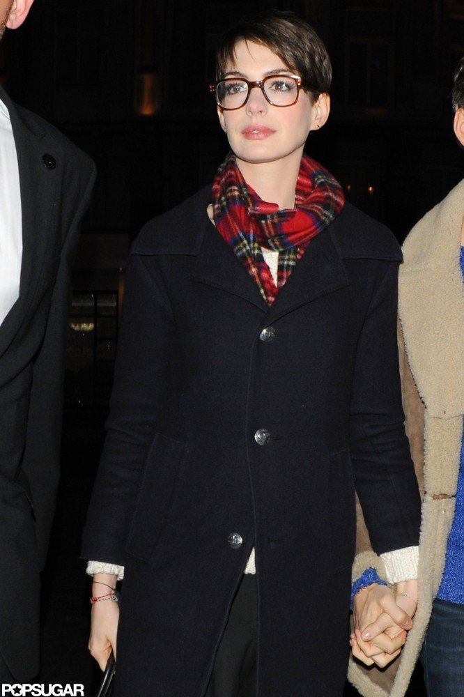 Anne Hathaway held her husband's hand.