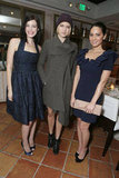 Olivia Munn, in a navy blue ruffled cocktail dress, posed with fellow actresses Jessica Paré and a wintry-looking Cody Horn.