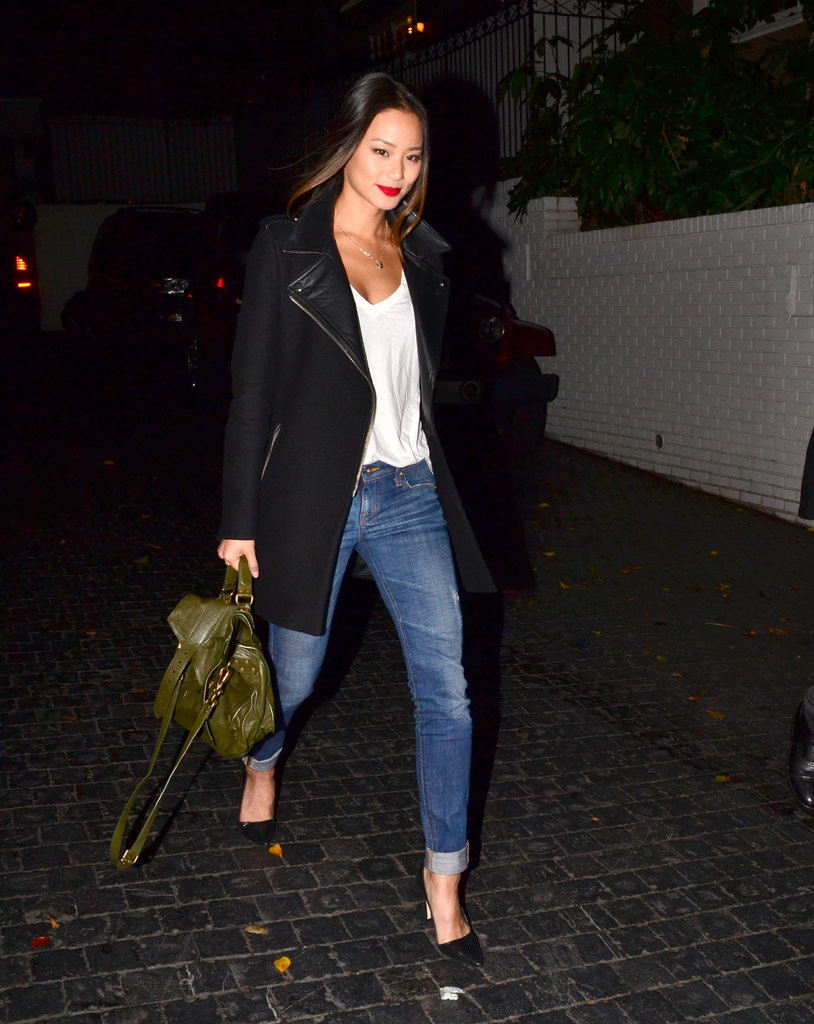 Jamie Chung gave us the coolest rendition of jeans and the white tee with a moto-style coat, Alice + Olivia pumps, and a gorgeous green PS1 in tow.