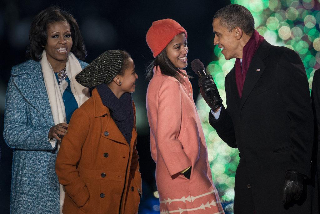 The president encouraged daughter Malia to sing some carols.