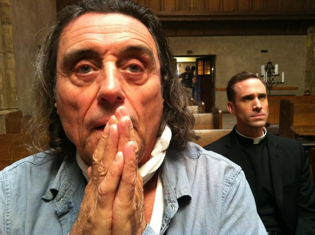 Ryan Murphy shared a cryptic picture of Ian McShane with Joseph Fiennes on the set of American Horror Story (or maybe it's just a Christmas party). Source: Twitter user MrRPMurphy
