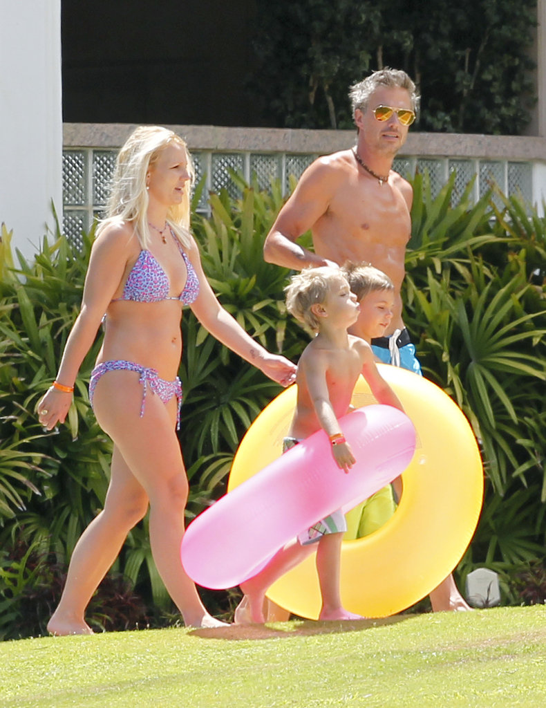 Britney Spears lounged in a bikini while spending time with then-fiancé Jason Trawick and her sons, Jayden James and Sean Preston, in Maui in July 2012.