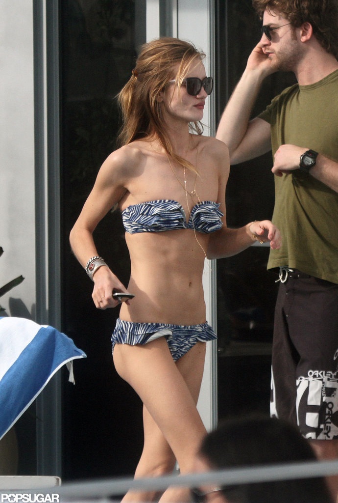 Rosie Huntington-Whiteley hit the hotel pool in Miami during a trip with boyfriend Jason Statham back in January.