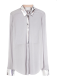 Tuck this 3.1 Phillip Lim Floating Bib Front Shirt ($475) into a leather skirt and statement sandals for a modern party look.