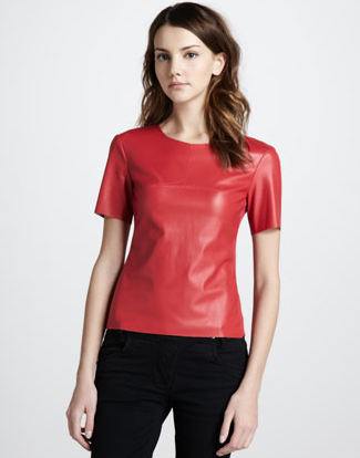 Show off this BCBGMAXAZRIA red faux leather top ($148) at all your upcoming holiday soirees. Pair it with black trousers, black patent pumps, and a shiny rhinestone necklace.