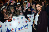 Victoria Beckham posed with fans in London.